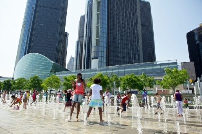 Kids play at the Detroit Riverfront fountains.