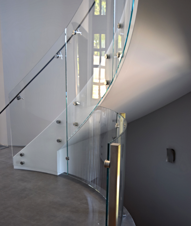 Bent Stair Glass Meeting Floor Railings Attached To Custom Posts Made In  House.