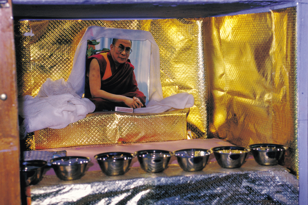 Each girl in the dormitory room has her own personal shelf space.  This is Llama's altar with an image of the Dalai Lama, spiritual leader of Tibet.