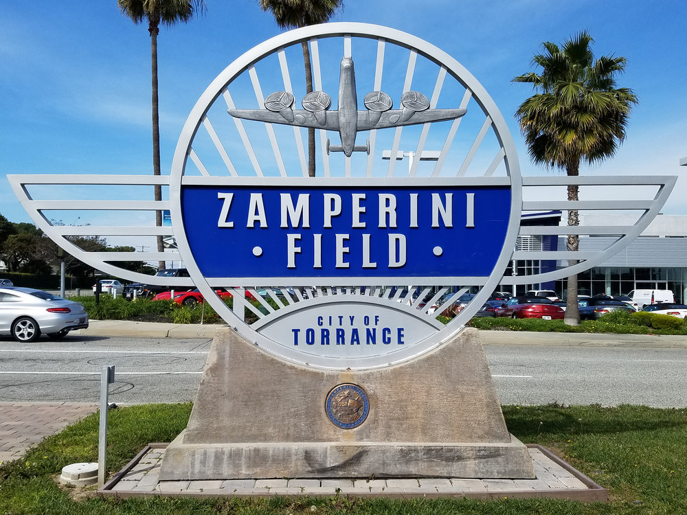 There is plenty of convenient FREE parking at Zamperini Field.