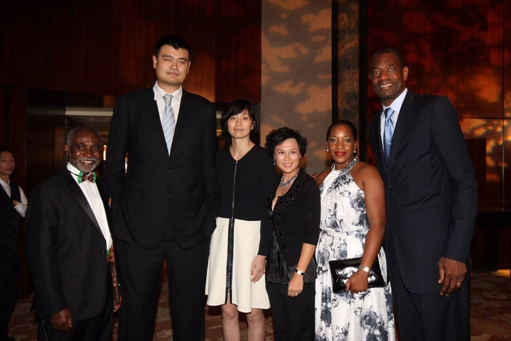 yao, dikembe, oba and wives.jpg