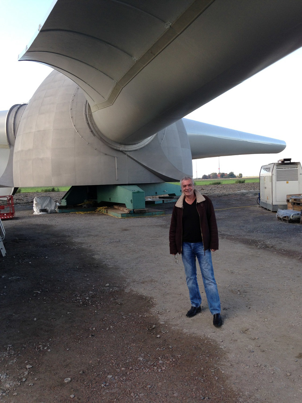 Ralph Ruppert, CEO, with the biggest commercially available wind turbine in the world in the background
