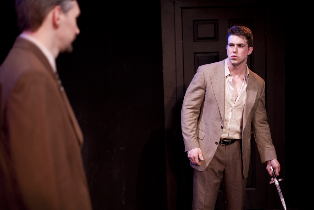 Production image of Claudius (David Bodenschatz) and Laertes (Mat Leonard) in  May Violets Spring  when produced with  Dare Lab  at The Bridge Theatre in Spring 2014.  Photographs by  Trish Phelps .