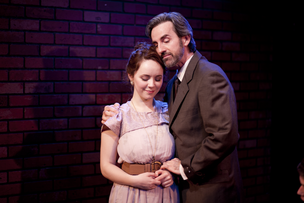 Production image of Ophelia (Gwenevere Sisco) and Polonius (Michael Griffin) in  May Violets Spring  when produced with  Dare Lab  at The Bridge Theatre in Spring 2014.  Photographs by  Trish Phelps .