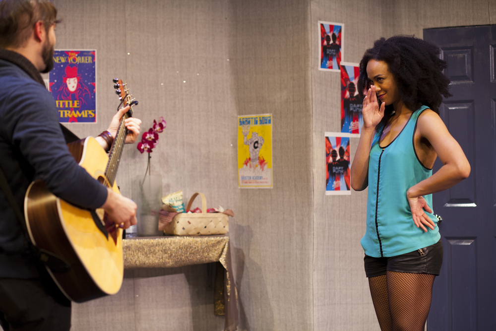 Production image of James Pearce (James Parenti) and Monique Jackson (Monique St. Cyr) in  POPTART!  when produced by  Girl Just Died  at TADA! Theatre in Winter 2015.  Photograph by Trish Phelps.