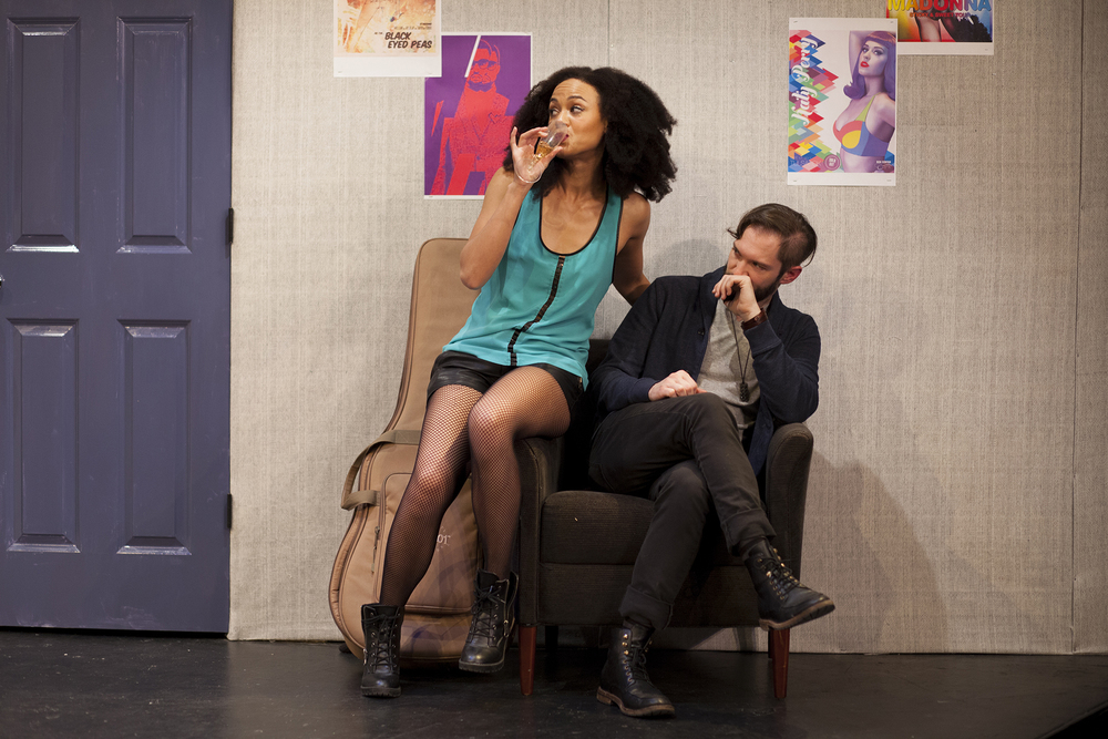 Production image of Monique Jackson (Monique St. Cyr) and James Pearce (James Parenti) in  POPTART!  when produced by  Girl Just Died  at TADA! Theatre in Winter 2015.  Photograph by Trish Phelps.