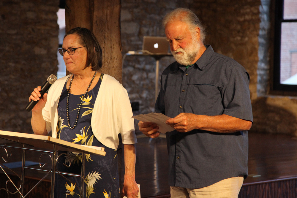Susan and david millstein accept a preservation achievement award for their work in saving many downtown buildings.