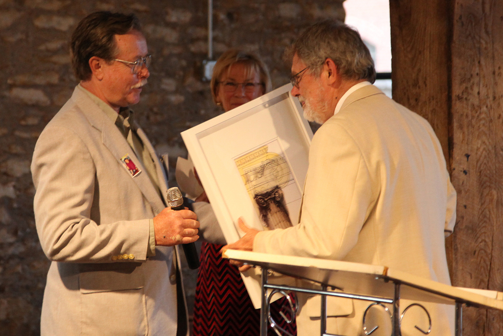 Michael Shaw, the first vice president of the Kansas preservation alliance, receives a preservation achievement award from LPA President, Dennis Brown.