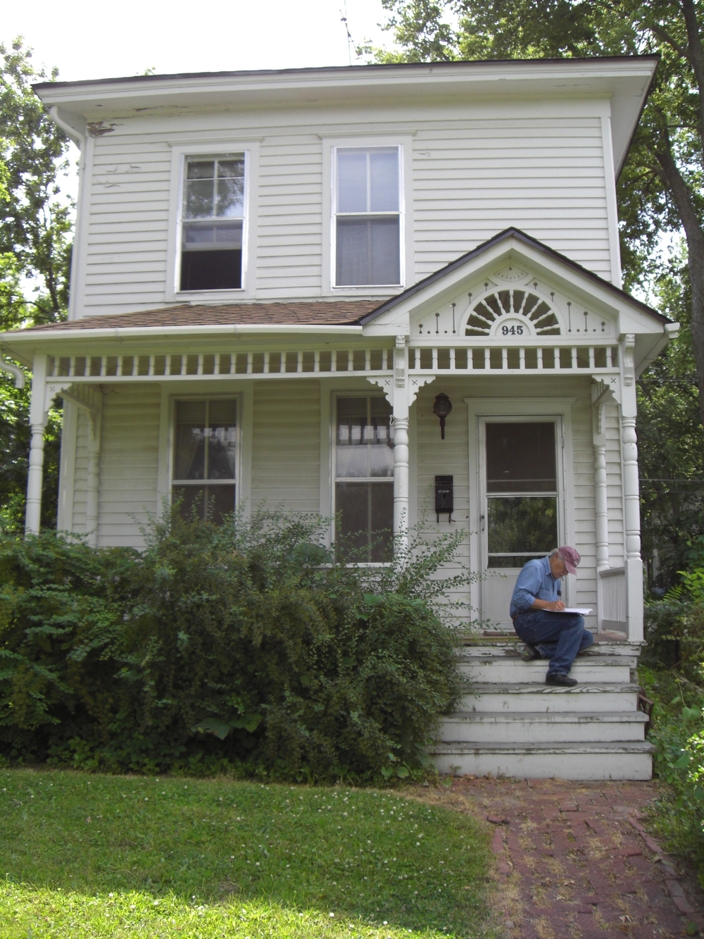 945 Delaware St. - Dennis Domer writes down notes on the architecture of the William H. Schell House, listed on the Lawrence Register of Historic Places