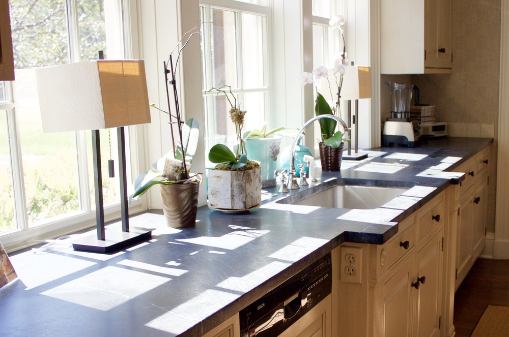 Alberene Soapstone forms the perimeter of the kitchen
