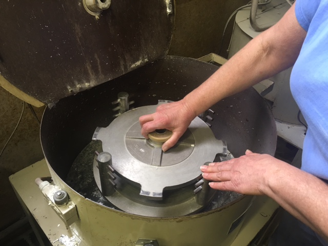 This is the spin casting machine. Pewter is poured in through the opening at the top of the mold. The pewter solidifies as the machine spins.