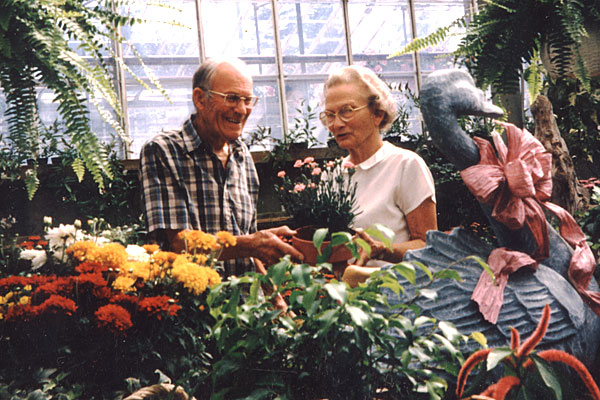 Ted and Frances visit in the greenhouse which played such an important part of their lives.