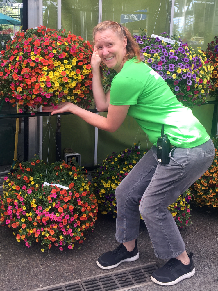 "Our annual's buyer, Liane, with some really awesome calibrachoa (aka millionbells). My bad joke for the day: What's a bro's favorite flower? Calibrachoa! (get it? It is pronounced ""cali-BRAH-koa"" - the best jokes are the ones you have to explain. ;)"