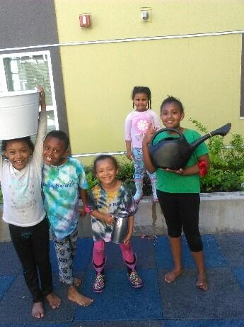 Compass Housing residents tending their garden*