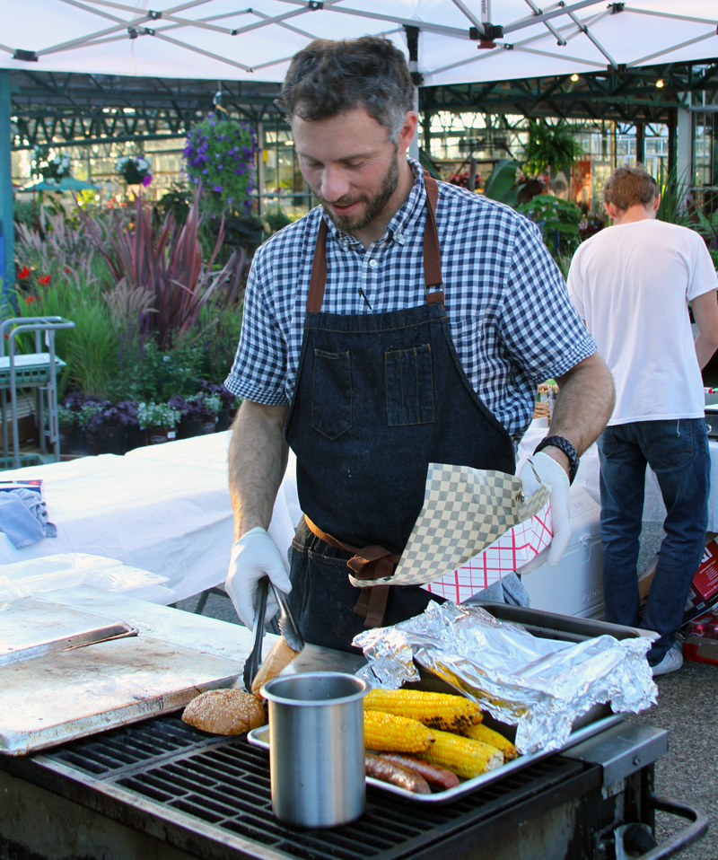 Casey, owner of Barn & Field, grilling at Family Night