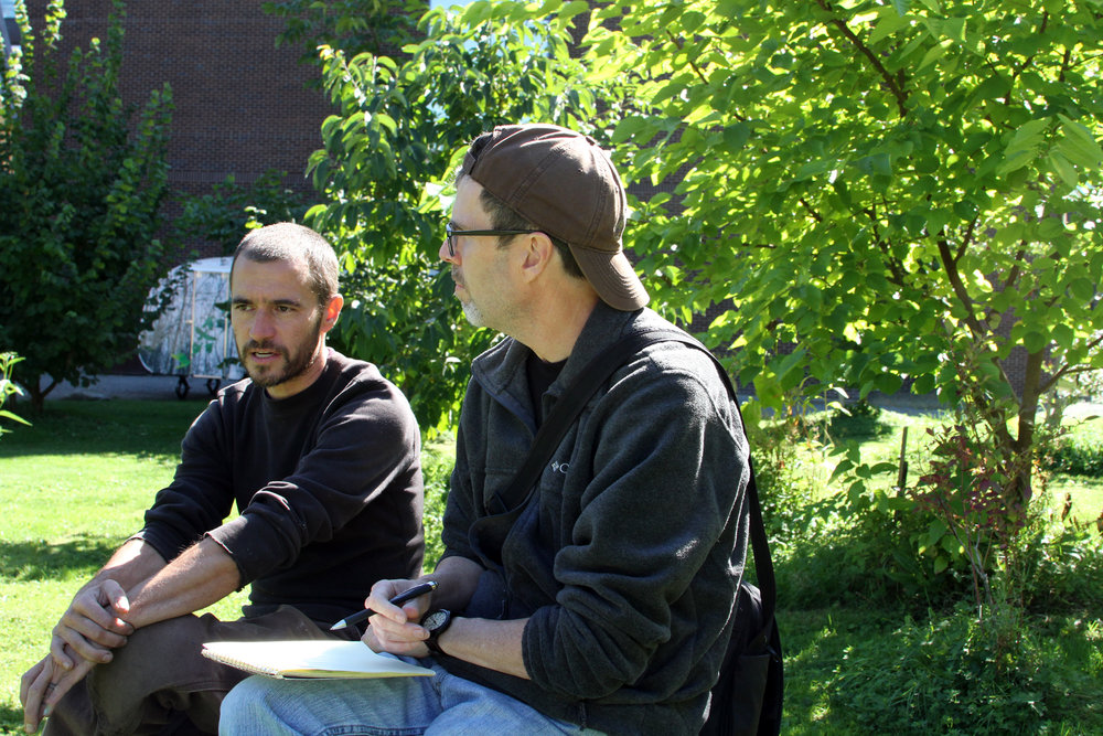 The author (right) talks with Tyson