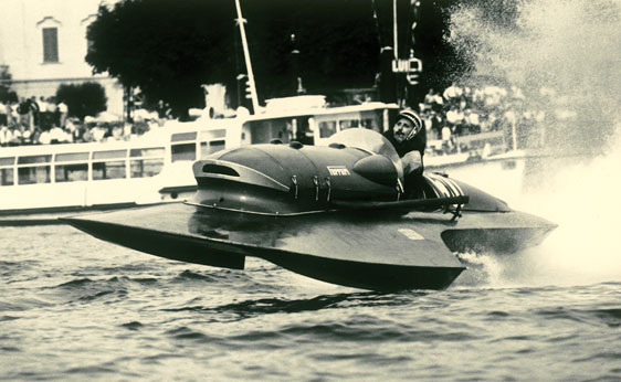 RM Auctions - Period shot of one of the racers crazy enough to pilot these at speed.