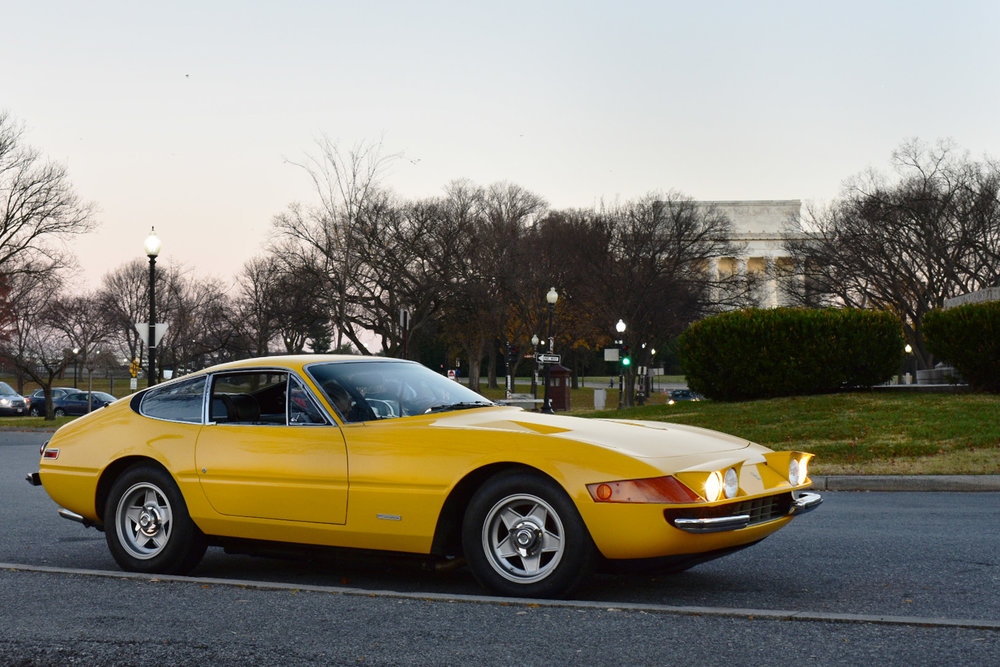 Ferrari parked by the Potomac River in front of the Lincoln Memorial