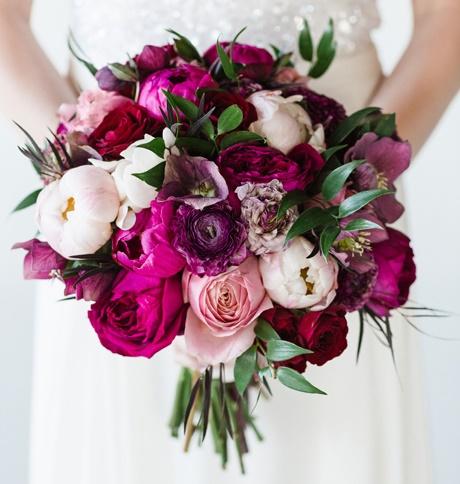 mixes pale pink, magenta, and burgundy peonies, roses, and ranunculus..jpg