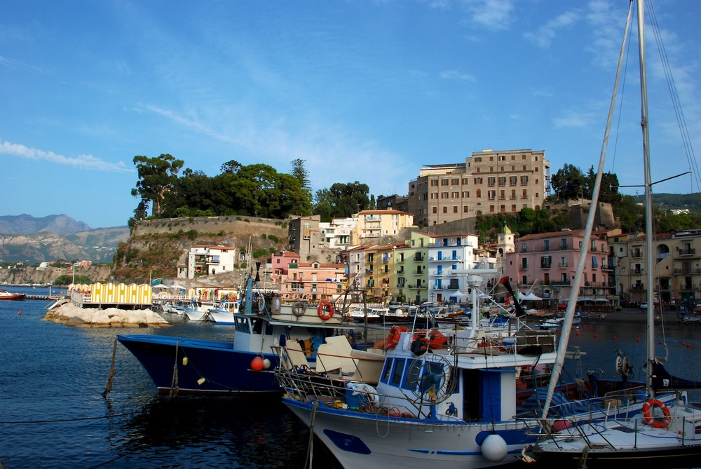 The view of the fishing village in Sorrento, Italy.  Sorrento is a good starting point and/or home base when exploring the Amalfi Coast.  The pizza here is great, and there are streets with shops and restaurants to explore for hours.