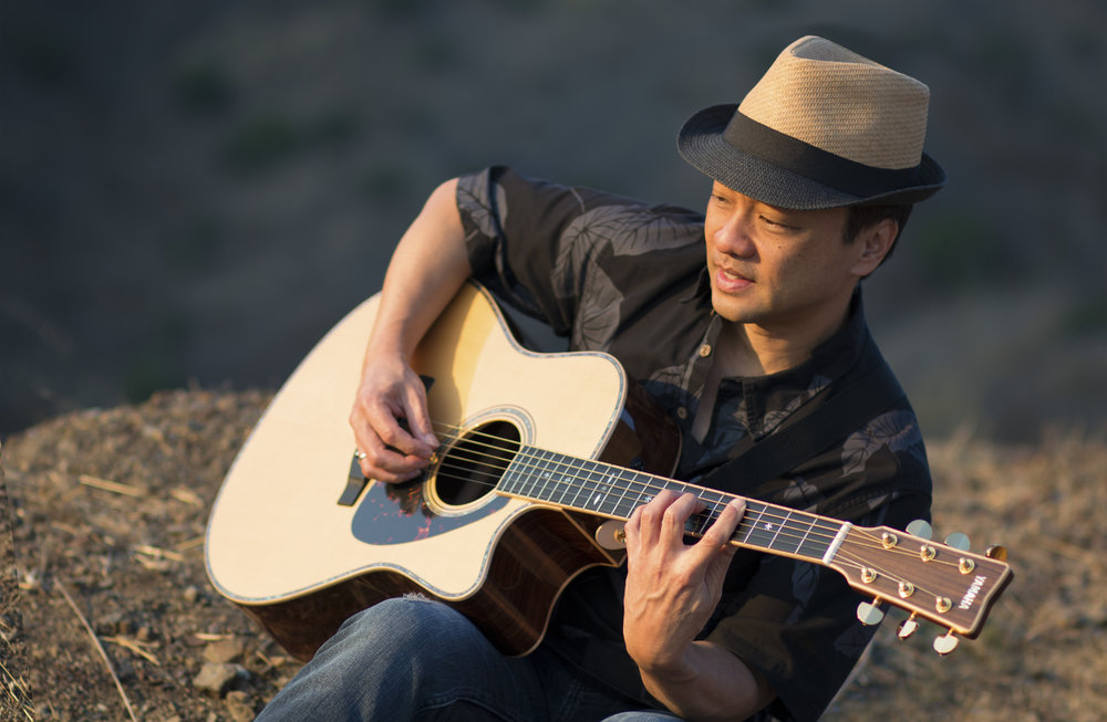 Daniel Ho with the Yamaha LLX36c Guitar