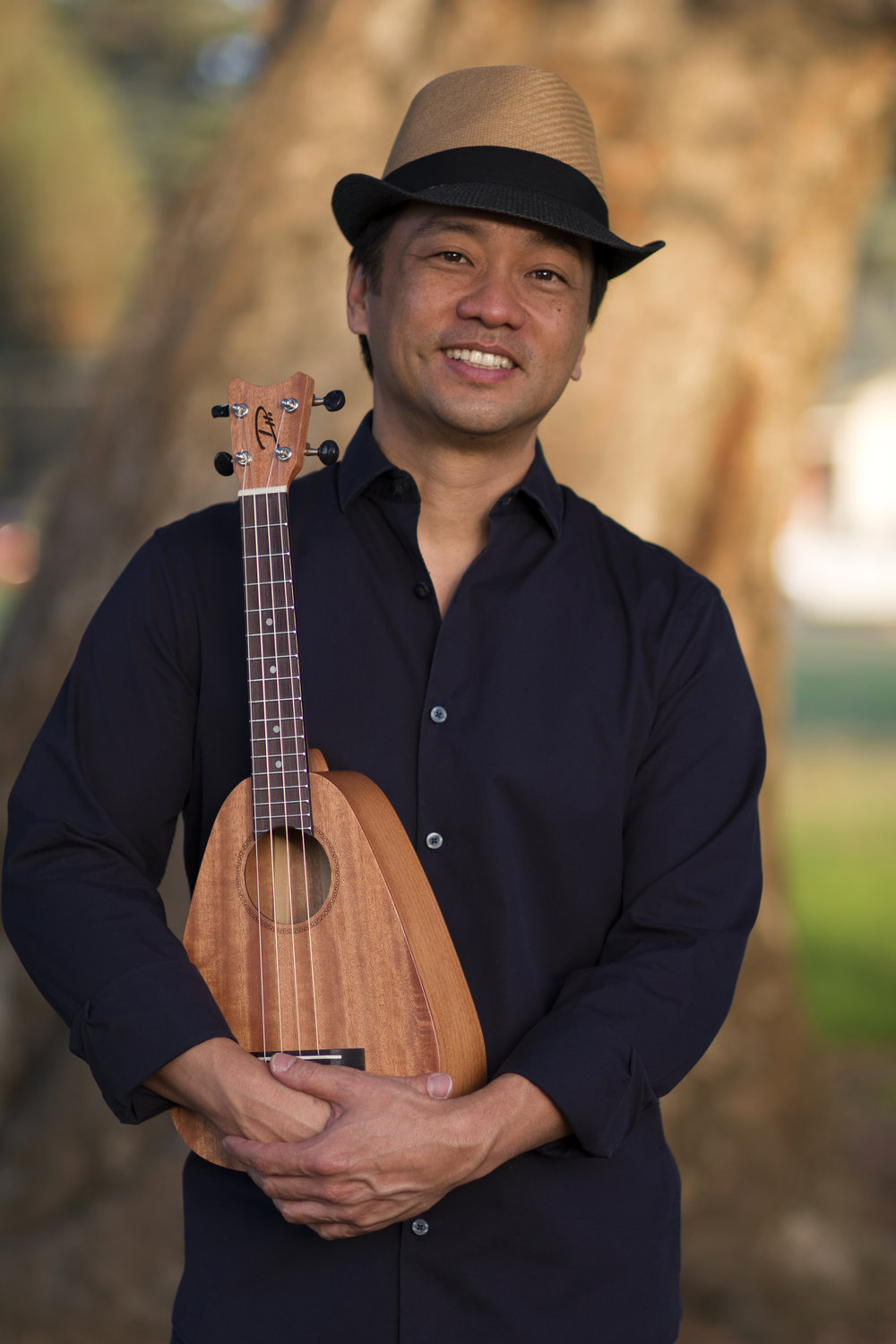 Daniel Ho with an ST Concert Ukulele by Romero Creations