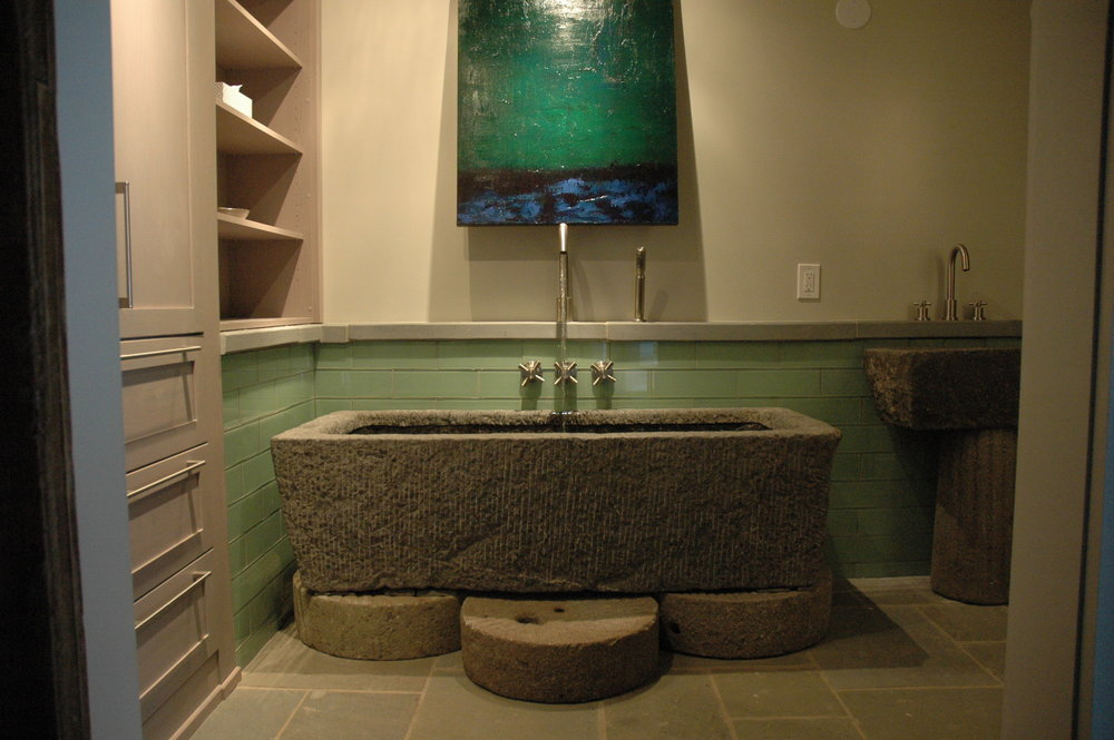One of our antique water troughs converted to a beautiful soaking tub