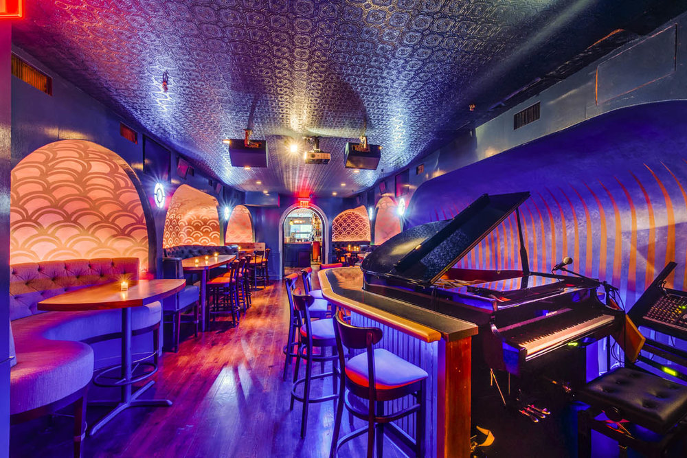 Hand Painted Wall Patterns create a unique experience in this popular piano bar -