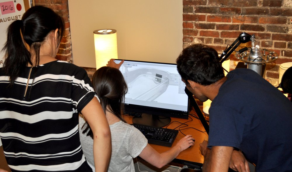 Team CAD discussion using one of the newly donated ThinkStation from Lenovo.