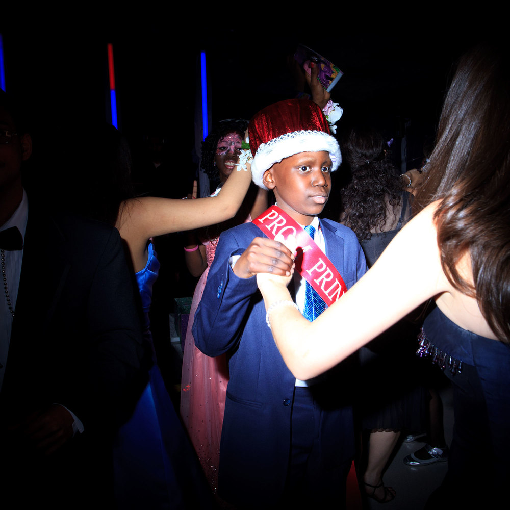 Jakai Fullerton 12, neuroblastoma, is asked to dance after being crowned Prom Prince at Montefiore Children's Annual Prom. May 2011, Bronx, NY.