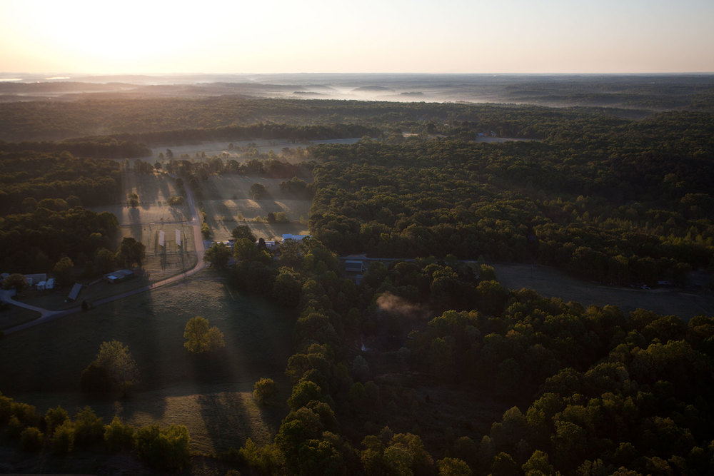 Aerial view of The Farm at dawn.