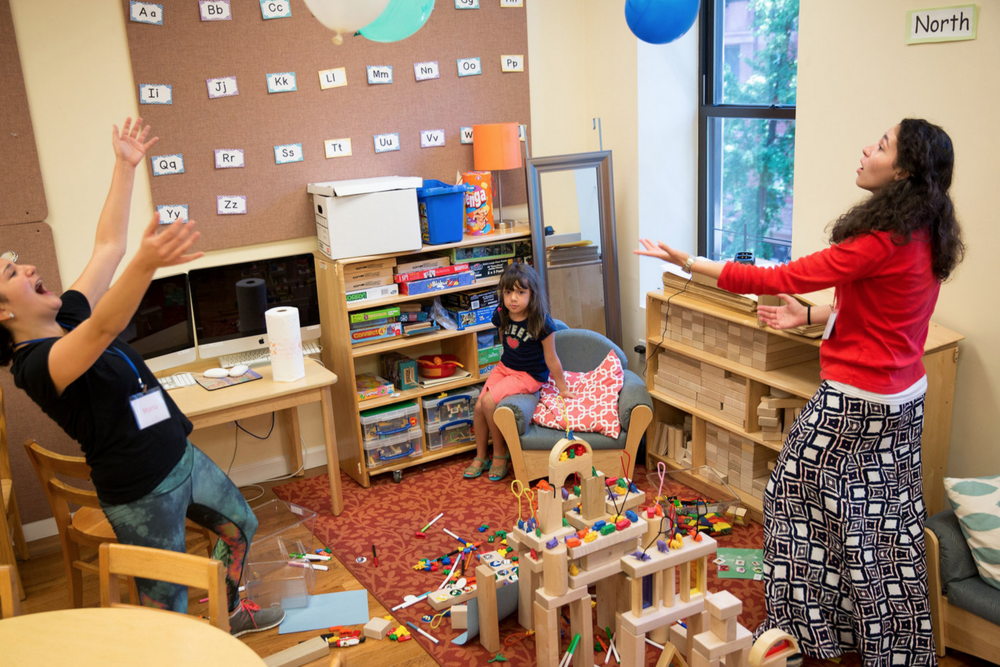 At the Child Mind Institute's Brave Buddies program at Columbia Grammar and Preparatory School in New York, teachers attempt to engage 5-year-old Lyla, a girl with selective mutism, by playing a game with balloons.