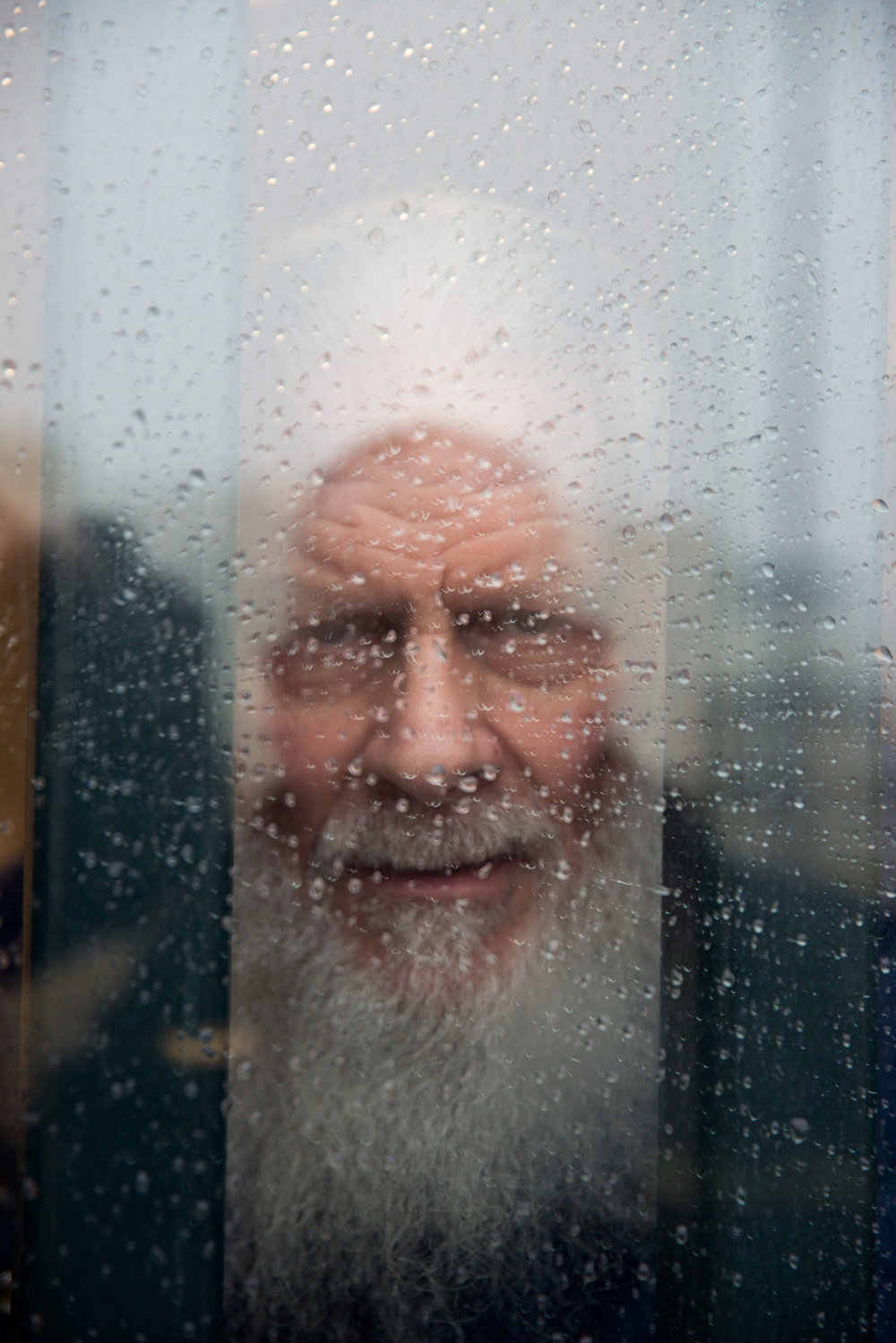Robert, 70, looks out his cell window. He has spent nearly 30 years in prison after being convicted of murder. In his free time, Robert mentors younger prisoners who have come in with drug addictions, something he's very passionate about.