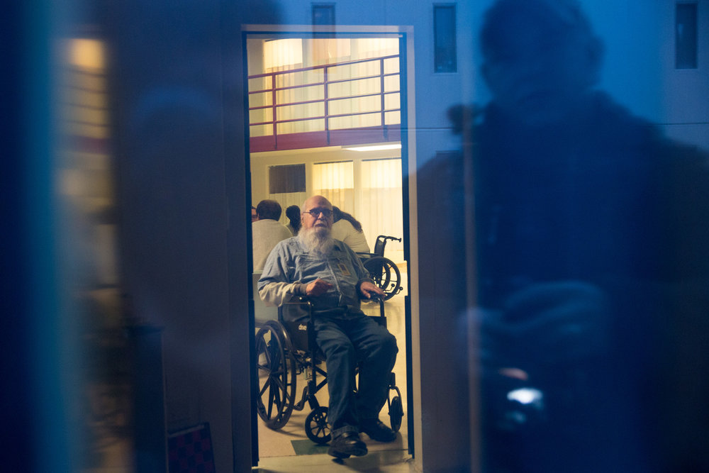 "Albert, 82 years old, through his cell window is about to be locked into his cell for the night. As a security guard makes a round of the premise. Albert grew up in foster care from the age of three to nine years old, and he's been in and out of prison since he was sixteen. ""If I wanted something in life at 3 years old I had to take it, if I needed food I had to take it, if I wanted a drink of water I had to take it. It wasn't given to me, you know."""