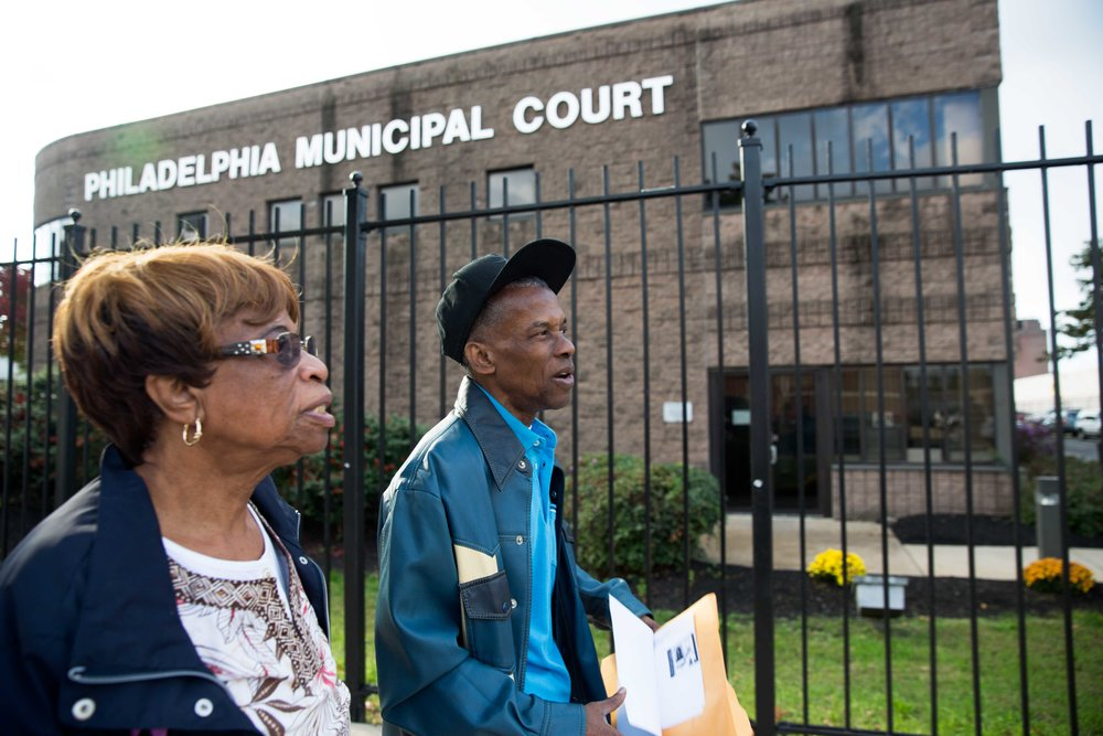 Ronald and his mother Willie Mae spend the day after Columbus Day fulfilling Ronald's parole obligations. He registers with the police department to get an ID; he goes to Philadelphia Traffic Court to prove he doesn't owe them any money even though he's never lived in Philadelphia as an adult; he then registers at the Philadelphia Criminal Justice Center. Willie Mae who doesn't travel farther than her immediate neighborhood, and Ronald who hasn't travelled at all in over 30 years, were both stressed that if they couldn't figure out how to do one of these things, he'd be sent back.