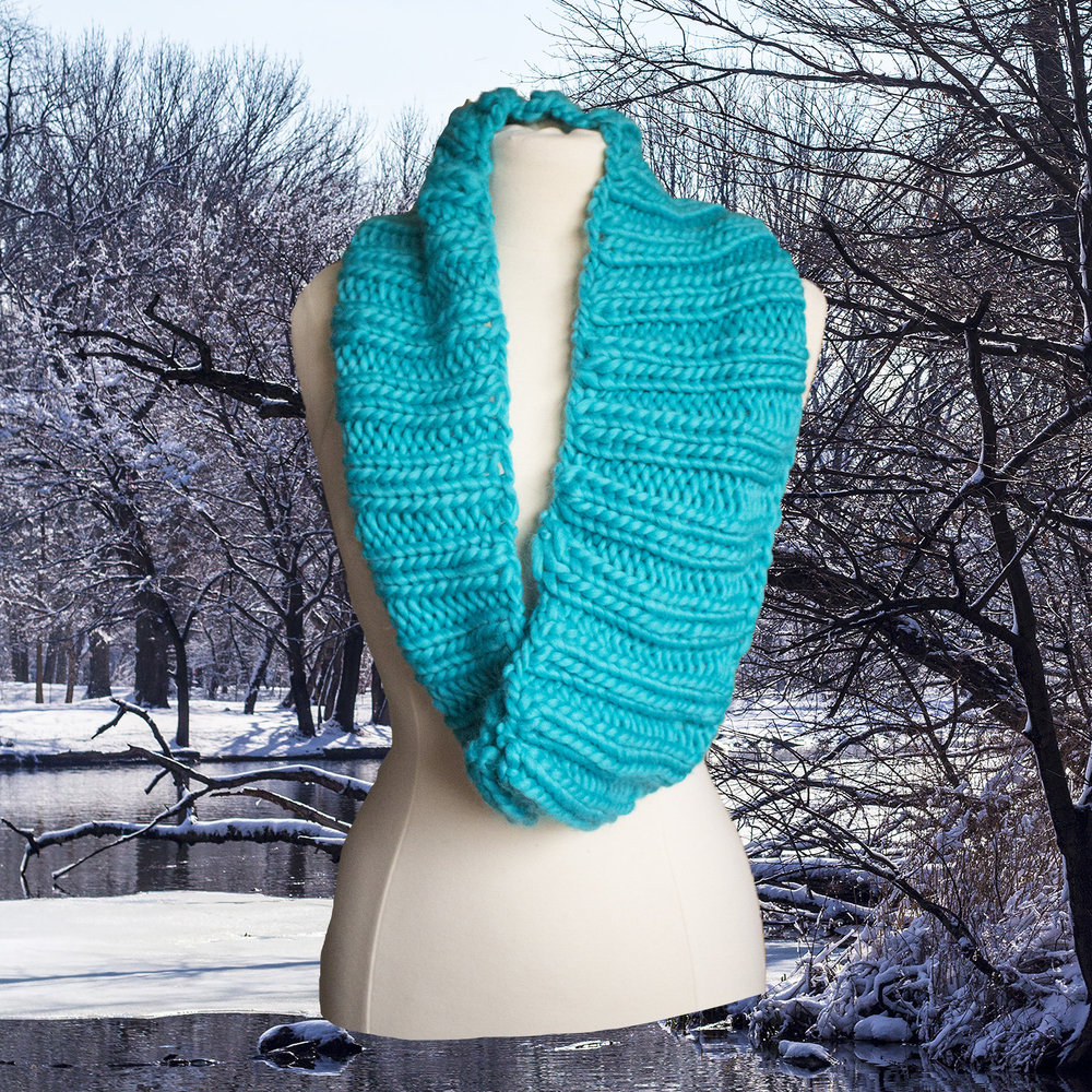This is our hand-knitted infinity scarf, in  turquoise . And Prospect Park in snow. Talk about a match made in heaven.