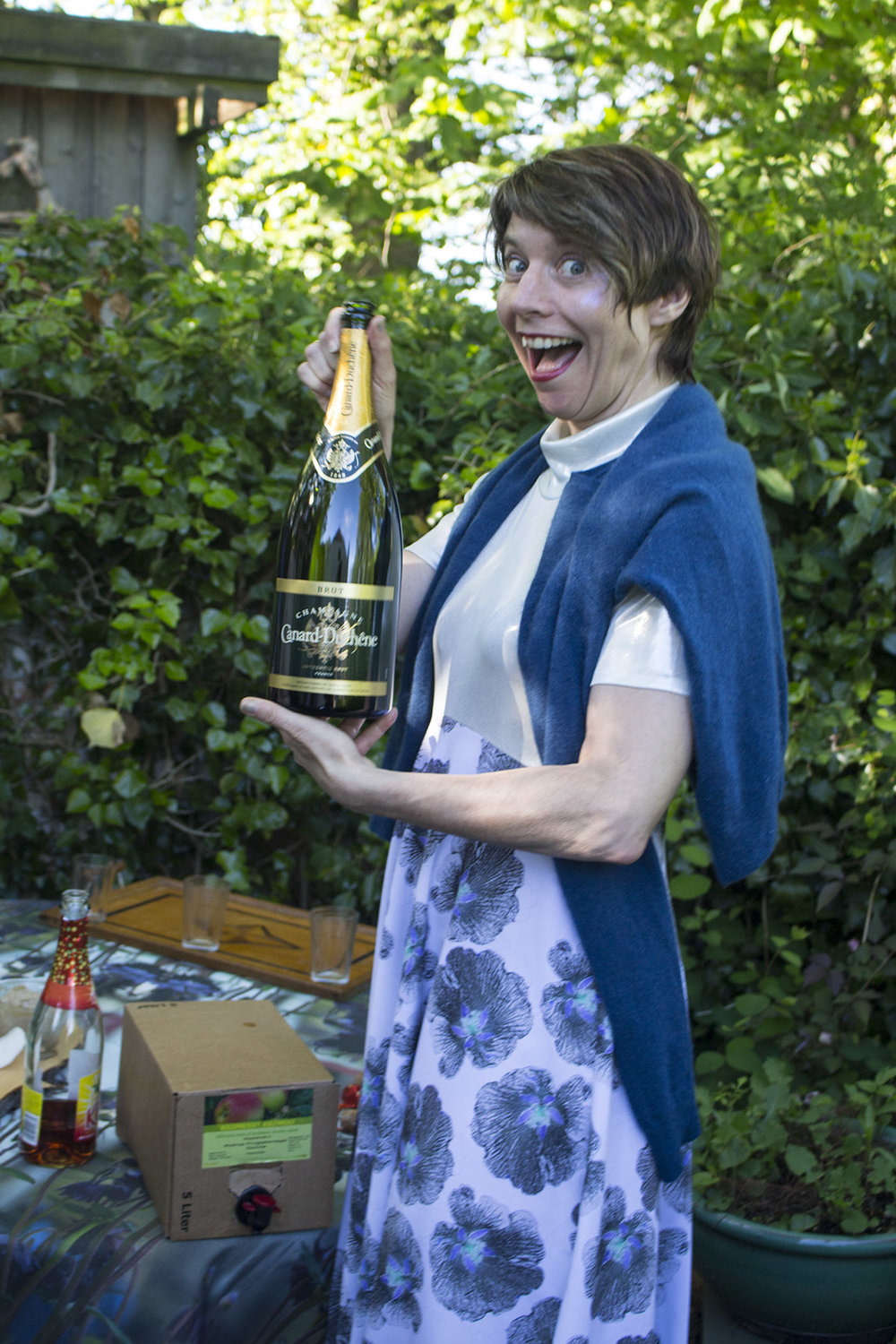 This is also me, celebrating mid-May 2017 in my mother's garden on Samsø, wearing the  Bente gown . I don't know that I'd always style it with a wool sweater and a magnum Canard-Duchêne (assume, um, not), but Denmark can be sort of chilly and who says no to bubbly?! Don't judge.