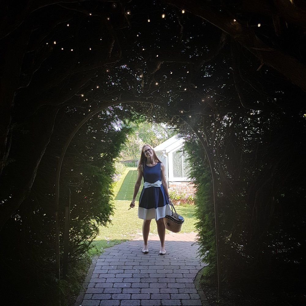 Pretty lights under this fantastic Yew Tree archway on the approach to the marquee.