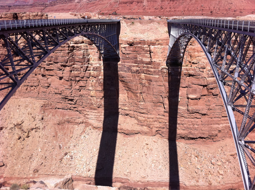 Two bridges overbite Colorado River northeast corner of Navajo Reservation AZ.  Automobiles left / pedestrians right.