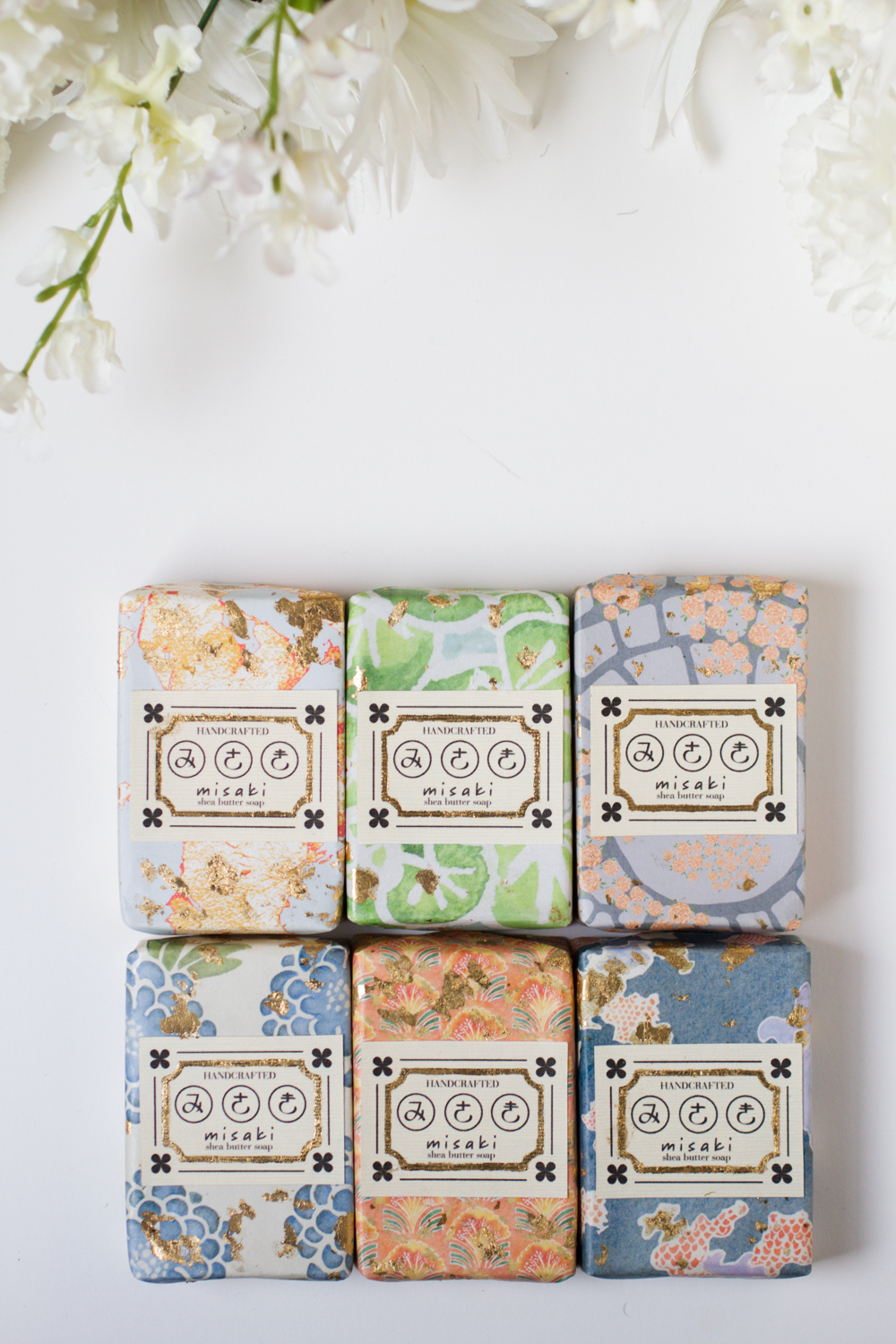 Mock up of a fictional soap brand, Misaki. Inspired by Chinese and Japanese imagery along with imagery that surrounds me daily, I wanted to transform and abstract these images into patterns that can be used for packaging. Soaps are handcrafted shea butter soaps infused with grapefruit and sandalwood essential oils with poppy seeds for exfoliation.  Photography by Christian Najjar