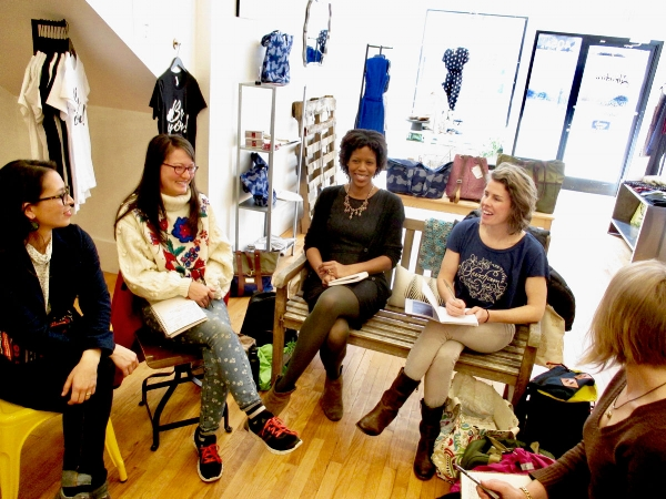 Liberation Threads boutique owner, Rebecca Kuhns, center, meets with local makers and entrepreneurs for Eco-Style Pop-Up