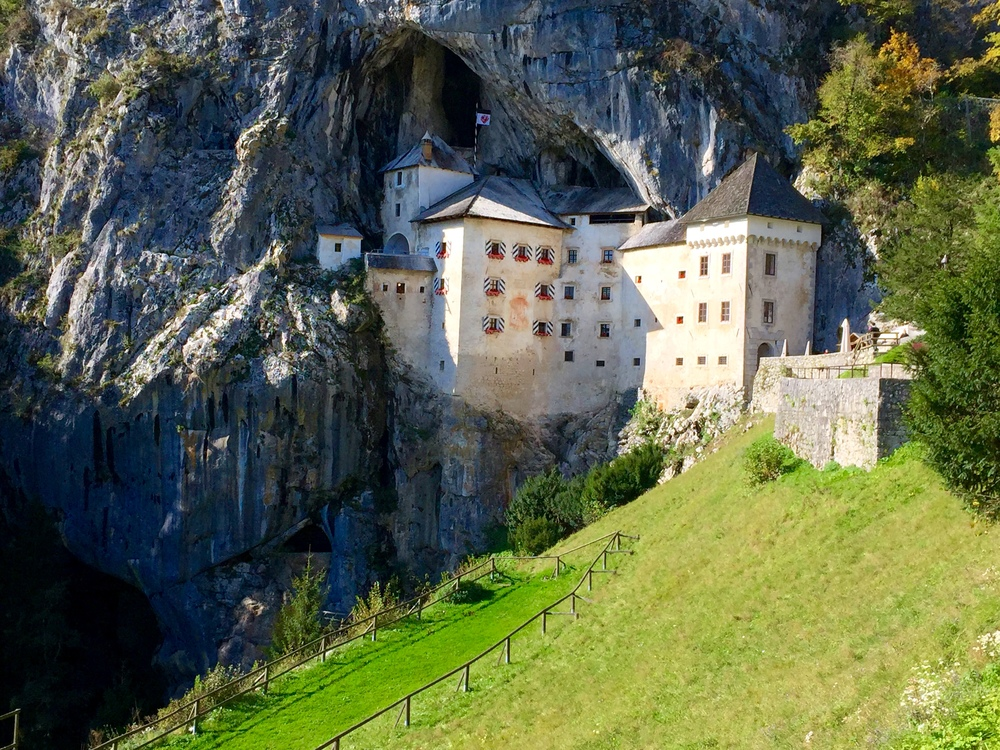 The Predjama castle built into the side of a cliff and cave (opening can be seen at the top of building).