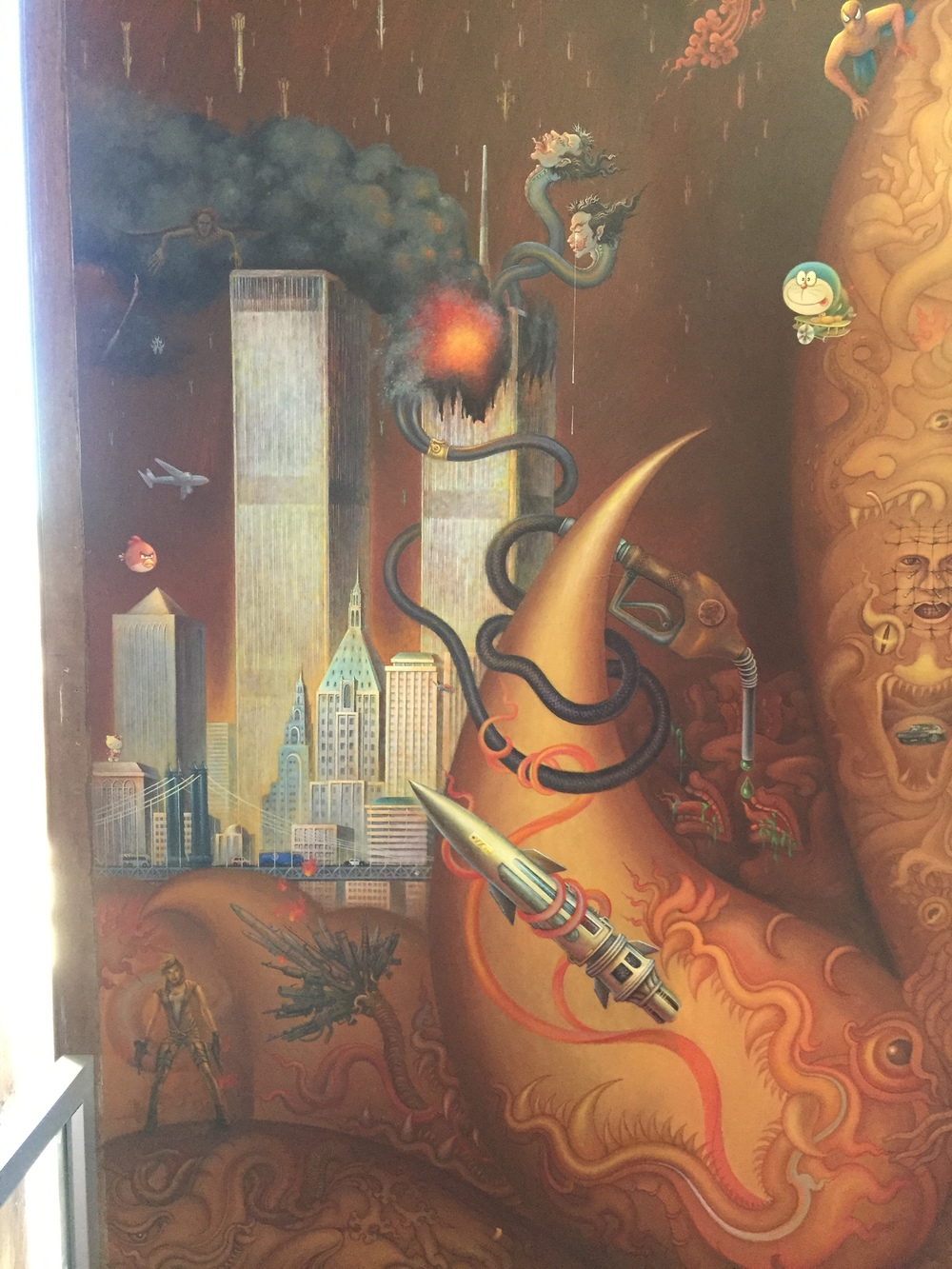 A small fraction of the images on the wall depicting good vs. evil. Shown here are the Twin Towers, gasoline, Spiderman, and others.