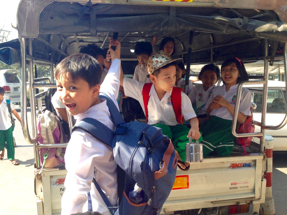 Kiddos excited to get to school in downtown Yangon
