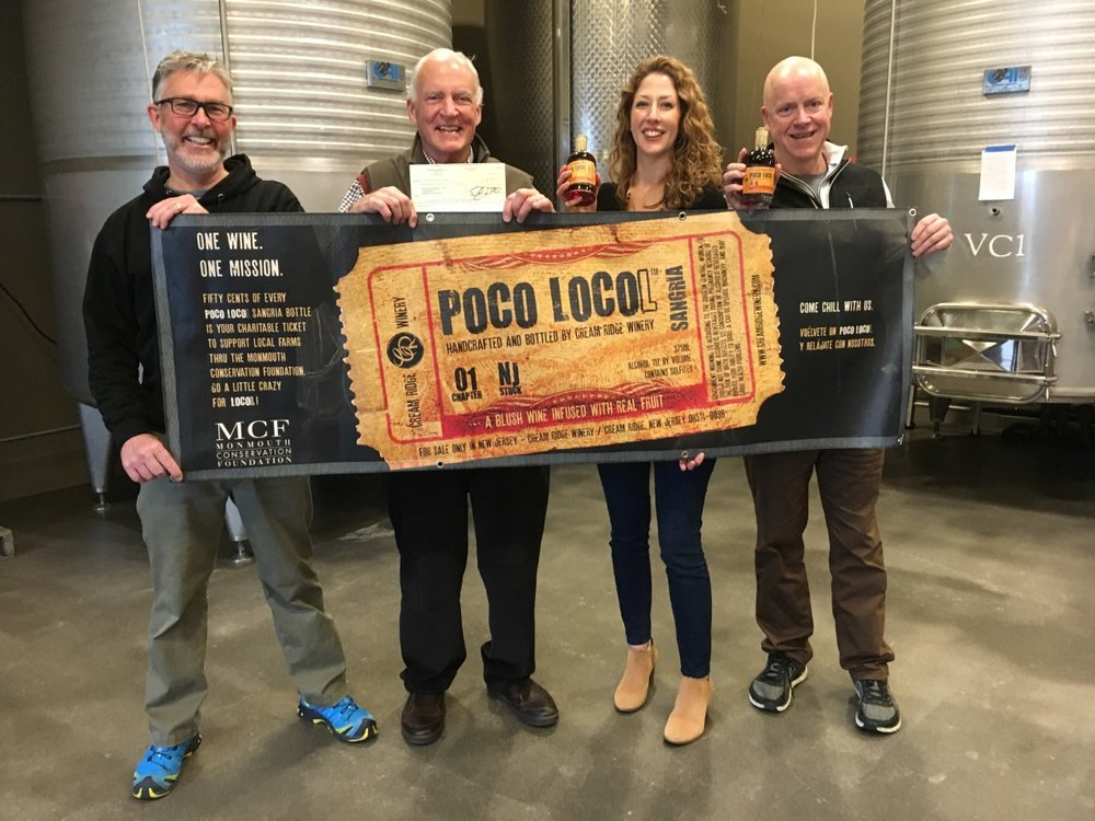 Jerry Amabile, William Kastning, Amanda Brockwell and Tim Schlitzer. Jerry and Tim present MCF with a donation check from the sales of Poco Locol sangria. Thanks Cream Ridge Winery!