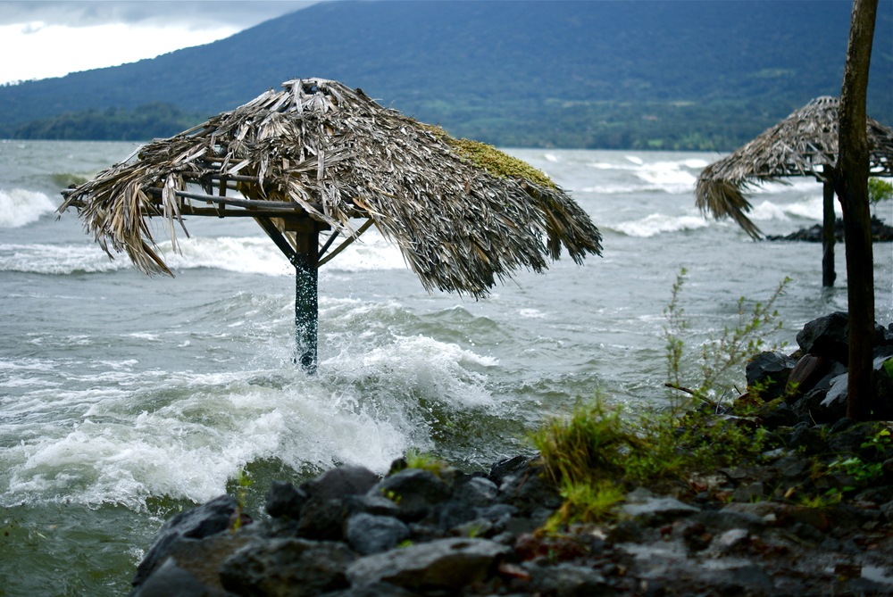 The waters of Lake Cocibolca crash against Maderas and Concepcion, the twin volcanos of Ometepe Island in Nicaragua.