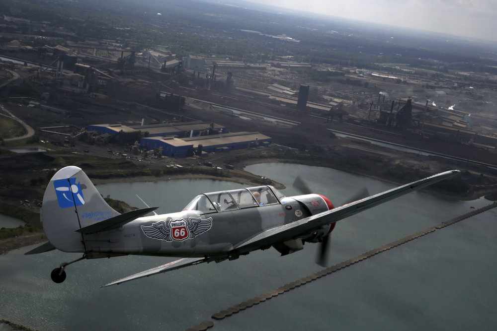 Pilot of Aerostar precision aerobatic demonstration team practices over Lake Michigan and Gary, Ind., for the Chicago Air and Water Show, Thursday, Aug. 17, 2017, in Gary, Indiana. (AP Photo/G-Jun Yam)