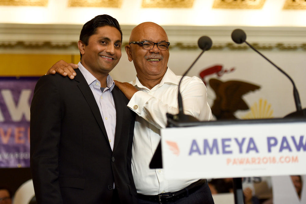 Democratic candidate for Illinois governor Ameya Pawar, left, stands next to his running mate, Cairo Mayor Tyrone Coleman, during a rally, the two candidates made their first public appearance, Tuesday, Aug. 15, 2017, in Chicago. Chicago alderman Pawar selected Cairo Mayor Coleman as his 2018 election running mate. Coleman is serving his second term as Cairo mayor. (AP Photo/G-Jun Yam)