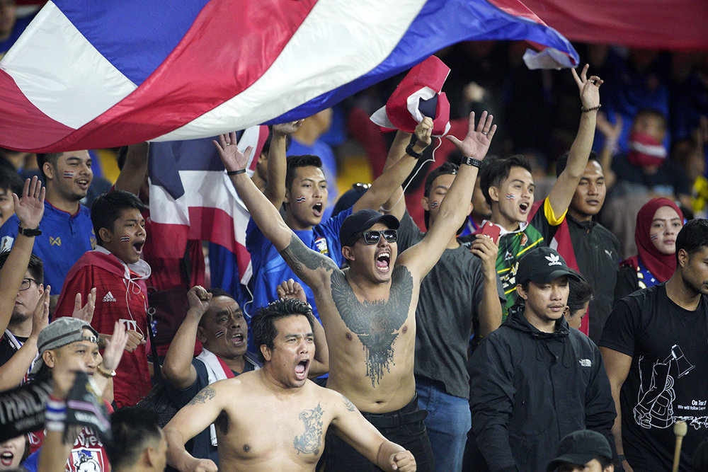 Thailand national football team supporters cheers before the AFF Suzuki Cup semi final against Malaysia at Bukit Jalil National Stadium in Kuala Lumpur, Malaysia, Saturday, Dec. 1, 2018. (AP Photo/Yam G-Jun)