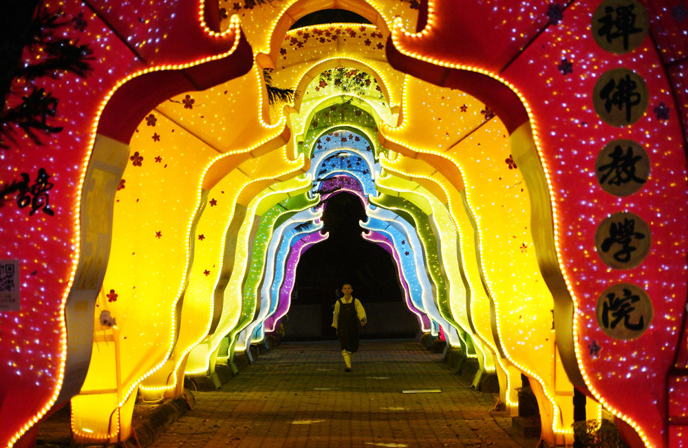 A ethnic Chinese monk walks at a temple in Jenjarom, Malaysia, Thursday, Jan. 31, 2019. Chinese around the world will be celebrating the start of the Year of Pig on Feb. 5 this year in the Chinese lunar calendar. (AP Photo/Yam G-Jun)